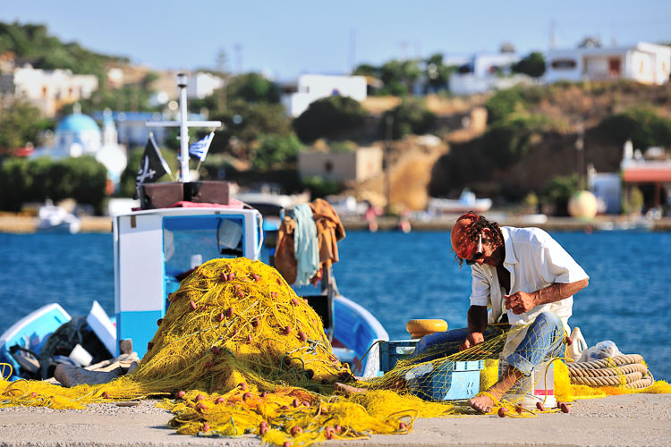 Sakkis the fisherman repairing his nets in Lipsi Harbour